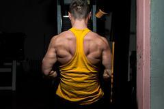 Male bodybuilder flexing his back Stock Photos