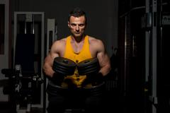 fitness trainer posing with dumbbells - stock photo