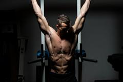 handsome man exercising his abs at the gym - stock photo