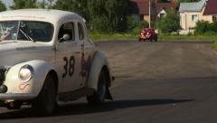 Two vintage cars Ford Coupe, Chevrolet Fangio on the drivevway Stock Footage
