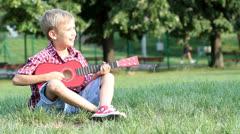 Boy play guitar Stock Footage