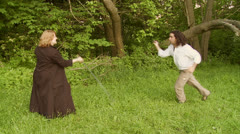 Dueling Couple 1s Stock Footage
