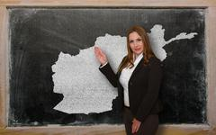 Teacher showing map of afghanistan on blackboard Stock Photos