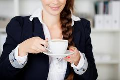 woman stopping for a coffee break - stock photo