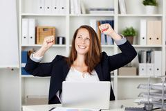 female expressing after achieving something - stock photo