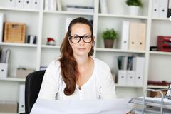 Portrait of beautiful woman with specs Stock Photos