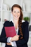 smiling portrait of a beautiful female executive - stock photo