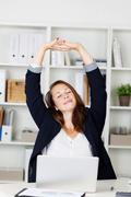 Businesswoman stretching her arms Stock Photos