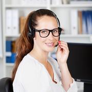 Female call center executive talking to a customer Stock Photos