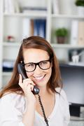Young female executive talking on the phone Stock Photos