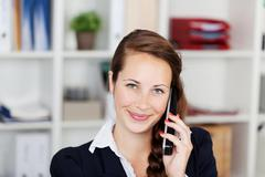 Efficient businesswoman speaking on the phone Stock Photos