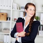 beautiful pensive businesswoman - stock photo