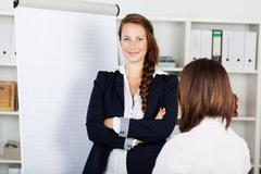 confident business woman with a flip chart - stock photo