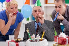 Happiness senior man on his birthday Stock Photos
