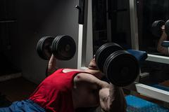 Young bodybuilder doing bench press for chest Stock Photos