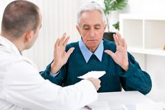 Shocked patient with prescription Stock Photos