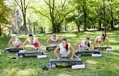 Group of a women doing exercises Stock Photos