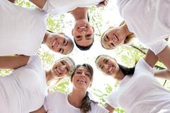 women with heads together - stock photo
