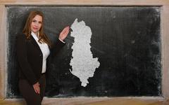 Teacher showing map of albania on blackboard Stock Photos