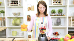 Brunette Girl Using Blender Fresh Fruit Juice - stock footage