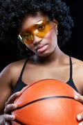 fancy african woman with basketball - stock photo