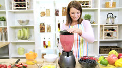 Healthy Caucasian Girl Making Fresh Fruit Smoothie Stock Footage