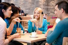 Teenagers enjoy in coffee Stock Photos