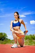 Stock Photo of sporty woman stretching quadriceps