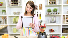 Young Female Wireless Tablet Blender Organic Fruit Drink - stock footage