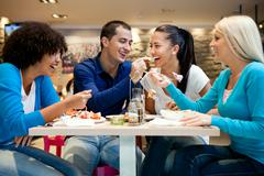 Group of teenagers enjoying in lunch Stock Photos