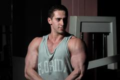 Young bodybuilder showing his upper body Stock Photos