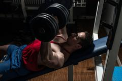 young bodybuilder doing bench press for chest - stock photo