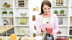 Young Female Using Blender Organic Fruit Drink - stock footage