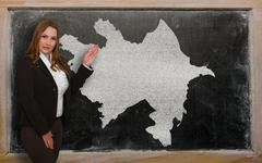 Teacher showing map of azerbaijan on blackboard Stock Photos