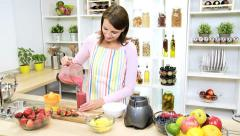 Caucasian Girl Pouring Glass Homemade Fruit Smoothie - stock footage