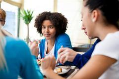 friends enjoying dinner at a restaurant - stock photo