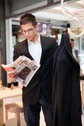 business young man  concerted  reading the newspaper - stock photo