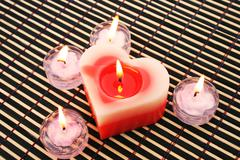 Red and pink candles Stock Photos