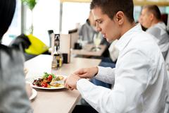 young couple enjoying lunch at a restaurant - stock photo