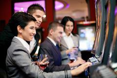 People gambling on slot machines Stock Photos