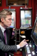 Man concentrate on slot machine Stock Photos