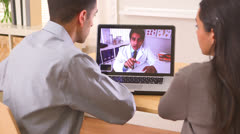 Stock Video Footage of Mexican couple video chatting with doctor