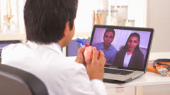 Hispanic doctor reassuring couple of positive results Stock Footage