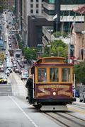 Cable car tram in san francisco climbing up the street Stock Photos