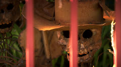 Metal Skulls With Hats Through Fence Bars In Old Town San Diego HD Video Stock Footage