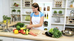 Healthy Caucasian Girl Slicing Fresh Vegetables Stock Footage