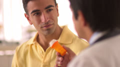 Mexican doctor explaining medication to patient - stock footage