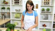 Stock Video Footage of Brunette Girl Kitchen Preparing Fresh Vegetarian Meal