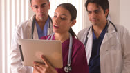 Team of Mexican doctors working on a tablet Stock Footage