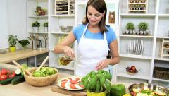 Girl Drizzling Olive Oil Buffalo Mozzarella Tomato Salad - stock footage